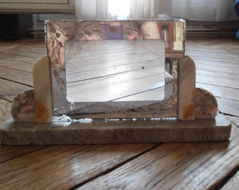 A French vintage Art Deco mirrored picture frame set in a marble base