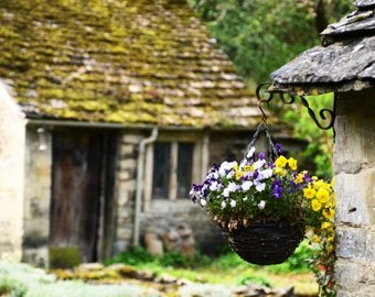 Flowers and History....the ancient village of Bibury in the Cotswalds, England.