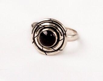 Vintage Silver Ring with a fine Onyx Gem .    Unique design.