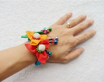 Cotton bracelet colorful fabric flower beads bells tribal jewelry shop knitting fashion design by leekingstudio