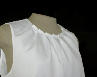 White top, folded neckline