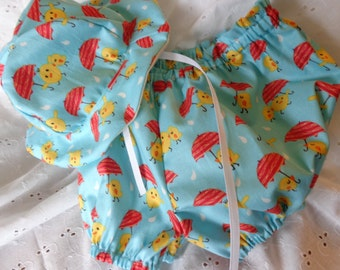 Sz 0 - 3 mths   Sun hat w/ matching bloomers.  Teal w/ yellow chicks holding umbrellas.  Sun hat, Bloomers,