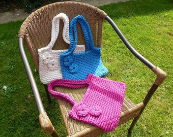 Hand made crochet shoulder bag/tote Using super bulky acrylic yarn. Button fastening. Other colours are available.
