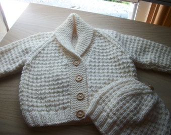 Hand knit baby cardigan and matching hat. To fit birth-3 months. Wooden buttons.