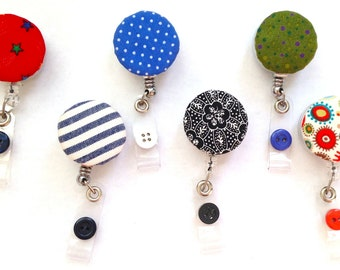 Retractable name badge holders