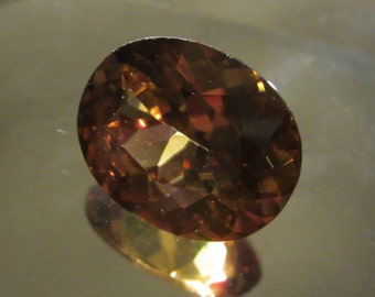 Golden Zircon 6.43 ct 12 x 10 calibrated clean Mindblowing Luster