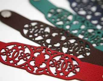 Laser cut leather bracelet cuff with ornate lace design