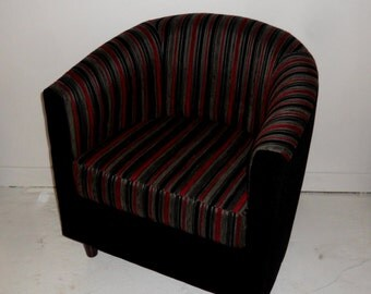 Tub Chair Upholstered In A Multi Coloured Stripe And A Plain Black Fabric