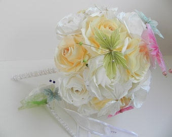 Wedding bouquet in pastel and white ivory colors with its butterflies