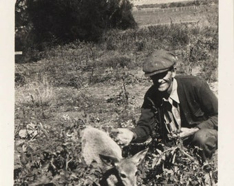 Vintage photo Man in Field with baby Deer