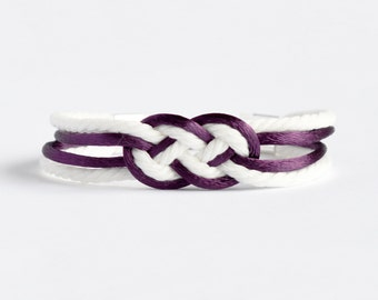 Dark plum purple and matte white double infinity knot nautical rope bracelet with your choice of silver anchor, heart or ship wheel charm