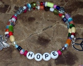 HOPE - FAITH - AWARENESS- any word  your choice - unique glass & metal beads  memory wire - charms - multi-colored beads- organza gift bag