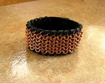 """Black Leather bracelet with Copper Chainmail - chainmail whip-stitched on a 1.5"""" wide S or M black leather bracelet, with two ball buttons"""