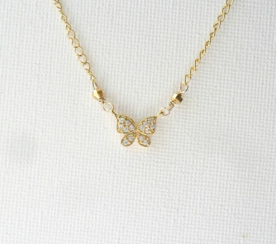 Simple gold necklace layering butterfly cubic zirconia like this item aloadofball Image collections