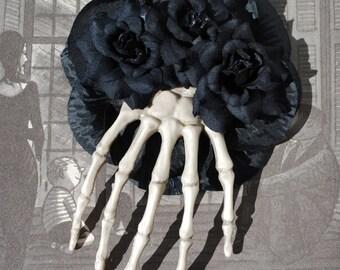 Halloween big skeleton hand with black roses and black petals gothic psychobilly Dia de los Muertos