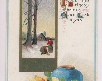 Antique Birthday Postcard with Good Luck Wishes featuring a Snow Scene and Yellow Roses and  Blue Vase Still Life Rendering early 1900s Card