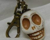 Skull Zipper Pull Backpack Fob Antiqued Brass Bone Color White Stone