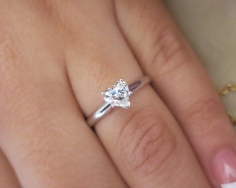 Single Solitaire White heart diamond engagement ring.