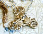 Whisper: Necklace w/ Antique French Art Nouveau Belt Buckle, antique Gold tassel, denim blue grey Swarovski. Old Hollywood glamour bride