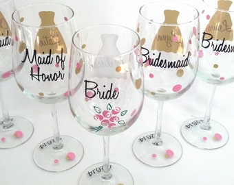 1 bridesmaid dress wine glasses, name over the dress, title on back, date on the base, your choice of colors.  Polka dots, flowers bouquet