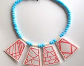 Geometric embroidered necklace hot pink pendants with light blue Native American trade beads and Ethiopian amber toggle