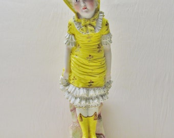 Late 1800's bisque figurine of Victorian girl, large size Victorian bisque figurine
