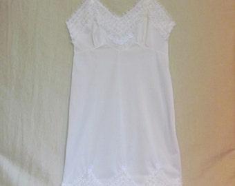 "Vintage nylon slip by ""Movie Star"" lingerie, 1950's size 38 lace trimmed slip"