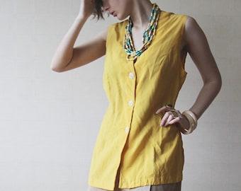 Bright mustard yellow sleeveless button up blouse