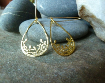 Nature inspired textured teardrop earrings in a stunning gold finish.
