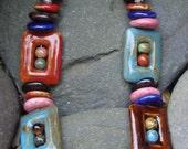 SALE Stunning ceramic bead necklace.Silver hook clasp, handmade charm