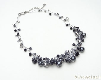 Black crystal necklace with hematite, stone and silver crystal on silk thread