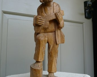 Carved wood sculpture: guitar player