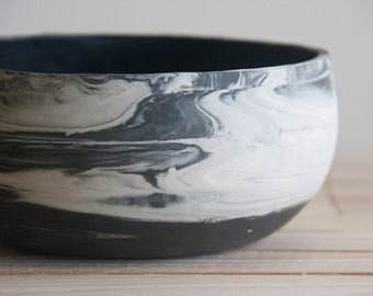 Marbled ceramic bowl in black and white. Handmade ceramic bowl with black glossy glaze