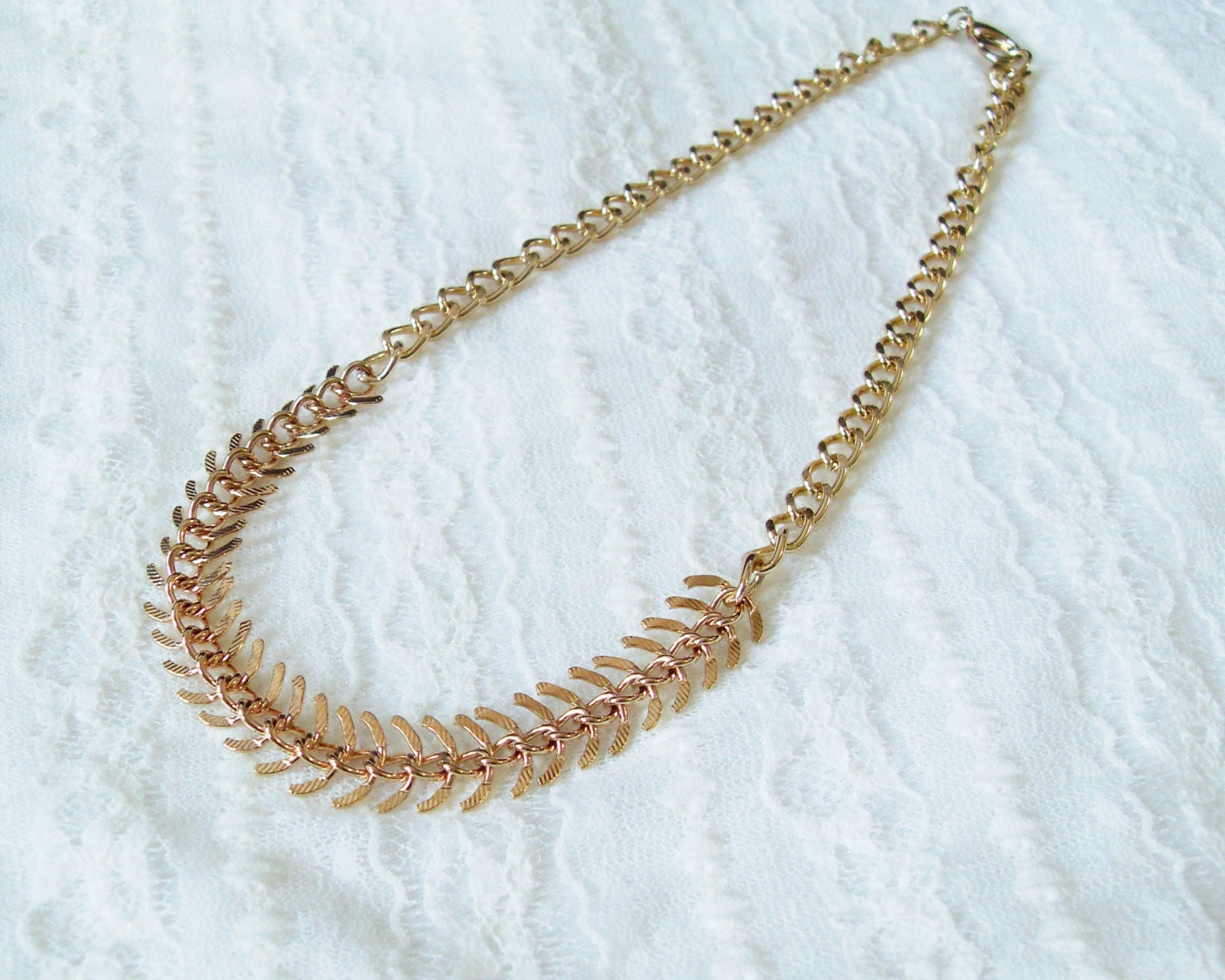 Gold fish bone chain necklace a chunky gold fish by for Fish bone necklace