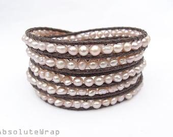 Peach pink freshwater pearl wrap bracelet on brown polyester cord, pearl wrap bracelet