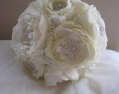 Beautiful bridal bouquet of artificial peony roses in ivory with rhinestone brooches and chiffon ribbon