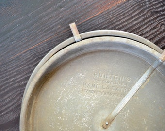 Set of 2 Tin Pie Plates Vintage Advertising Burton's The Old Reliable Vanilla Extract Standard for Over 50 Years Pie Pan Release Arm Shabby