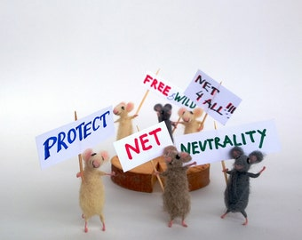 Protect NET neutrality. Miniature felt mouse on strike. Miniature animals fighting for the open internet.