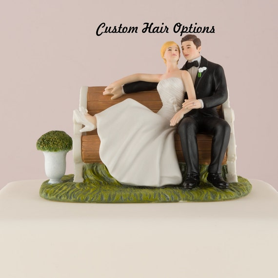 wedding cake topper personalized wedding couple sitting in the