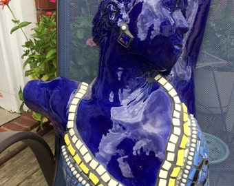 Female cermanic sculpture covered in broken ceramic tile