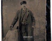 Man occupational book tintype photographer chair coat backdrop