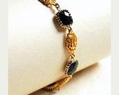 Matte Gold Oriental Filigree Black Gem Bracelet // 16K Gold Plated Filigree Channels // Faceted Black Glass Cushions