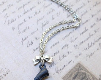 Black gun pistol and bow necklace