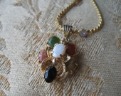 Vintage opal necklace surrounded by semi precious stones.  Gold 20 inch chain.