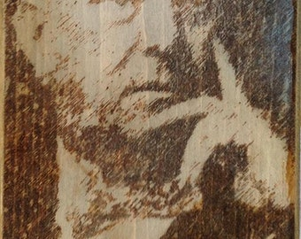 A pyrograph portrait of occultist Aleister Crowley - who introduced thelema to the world when he received the Book of the Law..