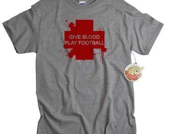 Football T shirt funny give blood sports tshirt league rec bloody injury cross women men teen youth ladies tailgate tee black