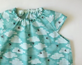 Baby smock 1-2 yrs - white clouds in blue sky black bird light blue baby girl dress apron shirt