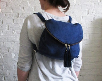 Convertible backpack in sapphire blue suede, fold over cross body bag with leather tassels, Day Traveler