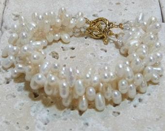 Natural Freshwater Dancing Pearls 4 Strand Bracelet in Gold