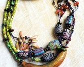 """Lampwork glass bead and polymer tribal statement necklace handmade by Lori Lochner """"Chartreuse and Purple pod necklace"""""""